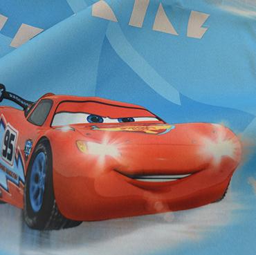 """Detailbild von Indes Fuggerhaus Stoff Sunicere mit den Stars des Films """"Cars""""."""