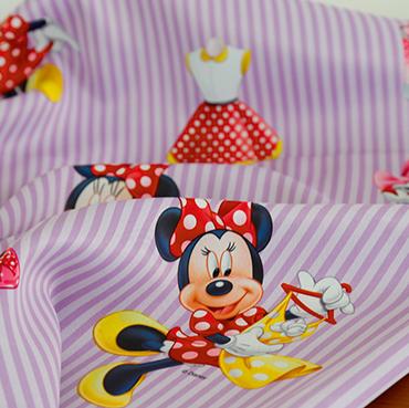"""Detailbild von Indes Fuggerhaus Stoff Sunshope mit den Stars der Serie """"Minny Mouse""""."""